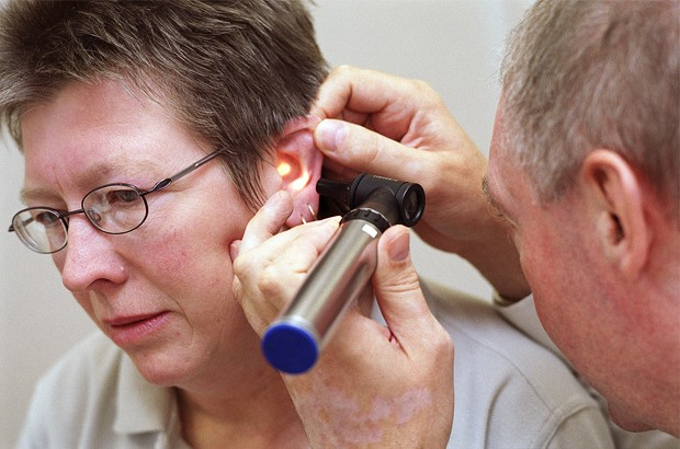 A female patient having an ear inspection